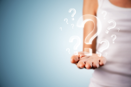 Blurry female hand holding drawn question marks on subtle background. Quiz and ask concept Stok Fotoğraf - 118913302