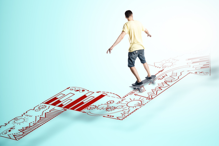 Young man skateboarding on abstract business sketch arrow on blue background. Career development and ambition concept