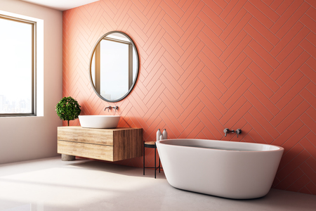 Side view of modern orange bathroom interior with decorative tree, bath tub, sink, round mirror, sunlight and copy space. 3D Rendering