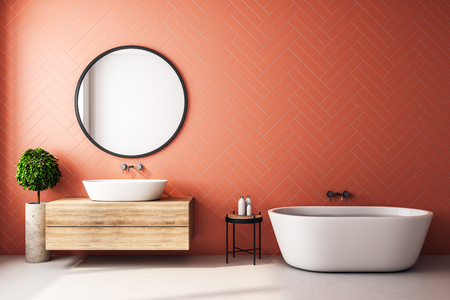 Modern orange bathroom interior with decorative tree, bath tub, sink, round mirror, sunlight and copy space. 3D Rendering Banco de Imagens - 119370394