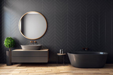 Interno nero moderno del bagno con l'albero decorativo, la vasca da bagno, il lavandino, lo specchio rotondo, la luce solare e lo spazio della copia. Rendering 3D Archivio Fotografico