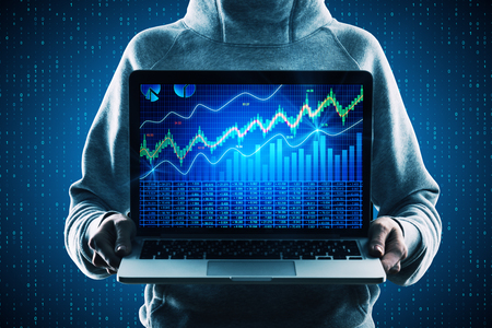 Hacker holding laptop with forex chart on screen on creative binary code background. Trade and computing concept Foto de archivo