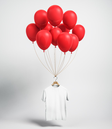 Empty white shirt with red balloons on light background with shadow. Shop opening, celebration concept. Mock up, 3D Rendering