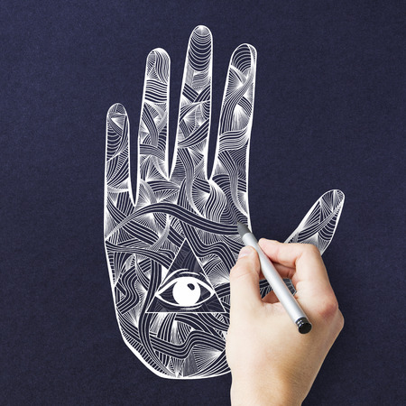 Creative esoteric mandala hand with eye drawing on blue background. Oriental ornament and hinduism concept Stock Photo