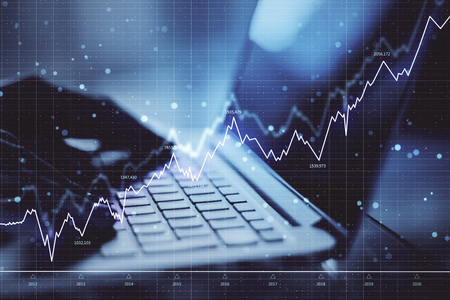 Close up of hands using laptop with forex chart. Network and trade concept. Double exposure
