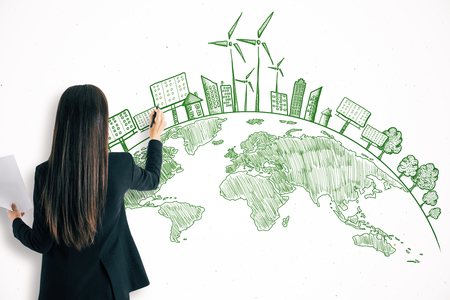 Businesswoman drawing creative eco globe sketch on white wall background. Eco-friendly and pollution concept Imagens