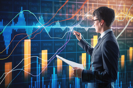 Attractive businessman with document in hand using creative forex chart interface on blurry background. Finance and trade concept. Double exposure