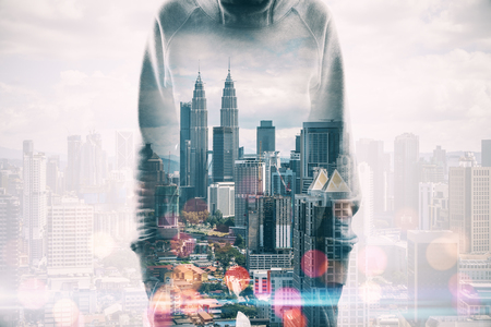 Hacker standing on blurry night city background with bokeh circles. Malware and hack concept. Double exposure Stok Fotoğraf