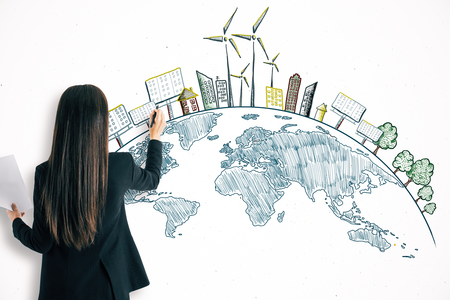 Businesswoman drawing creative eco globe sketch on white wall background. Eco-friendly and environment concept Фото со стока