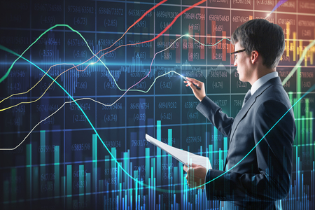 Handsome businessman with document in hand using creative forex chart interface on blurry background. Finance and trade concept. Double exposure Imagens