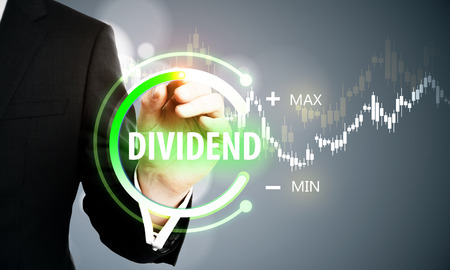 Close up of businessman hand using digital button touchscreen on blurry background. Dividend and innovation concept. Double exposure