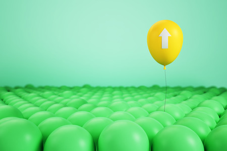 Creative yellow balloon with arrow above blurry green ones. Leadership and growth concept. 3D Rendering