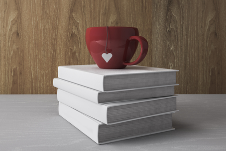 Stack of white books with red cup. Education Concept. 3D Rendering Stock Photo