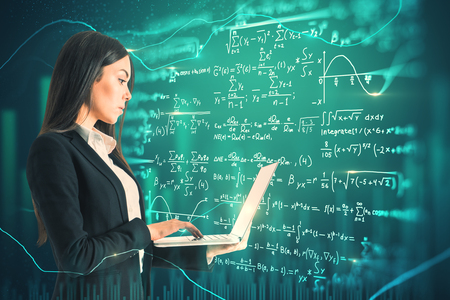 Side view of attractive young european businesswoman using laptop on abstract scientific formulas background. Technology and algorithm concept. Double exposure