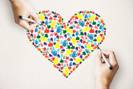 Drawing of colorful hand gesture heart on white background. Community, care, donation, communication and hope concept