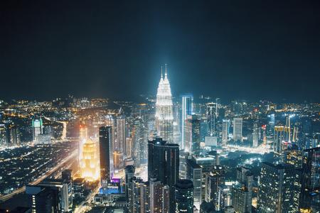 Creative night Kuala Lumpur city background skyline. Tourism and downtown concept Stock Photo