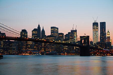 Creative dusk New York waterfront city skyline. Modern tourism concept Stock Photo