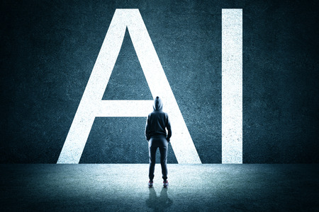 Back view of hacker looking at creative AI letters on concrete wall. Artificial intelligence and malware concept Stock Photo