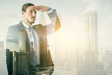 Side view of young businessman on blurry bright city background. Research and success concept. Double exposure
