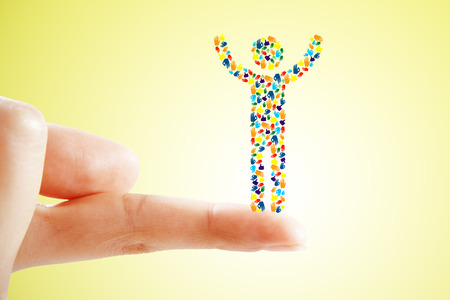 Finger holding creative hand gesture cartoon man on yellow background. Community and network concept