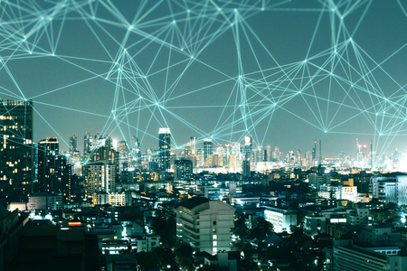 Night city skyline background with polygonal connections. Social media and network concept. Double exposure Stock Photo