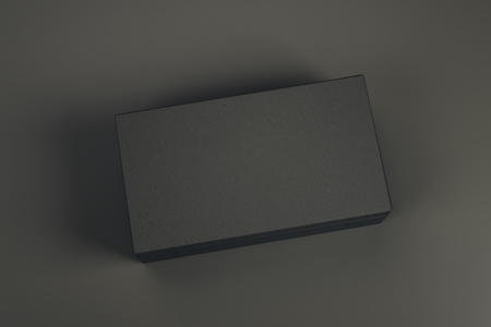 Empty black business card stack on dark table. Info, address and message concept. Mock up, 3D Rendering