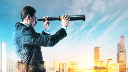 Side view of young european businessman using telescope on bright city background. Vision and future concept. Double exposure