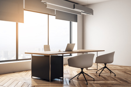 Contemporary office interior with desktop and chairs, window with city view and daylight, wooden floor and concrete walls. 3D Rendering Stock Photo