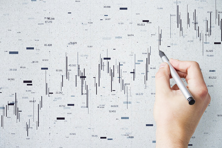 Hand drawing forex chart on concrete wall background. Trader and analytics concept 版權商用圖片