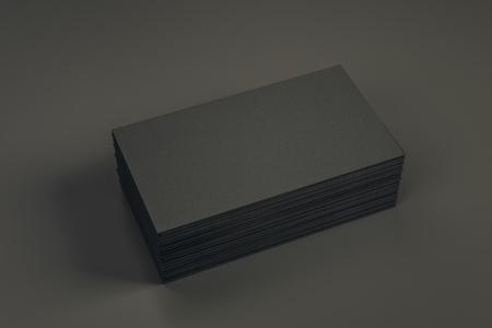 Empty black business card stack on dark desktop. Info, address and message concept. Mock up, 3D Rendering Stock Photo