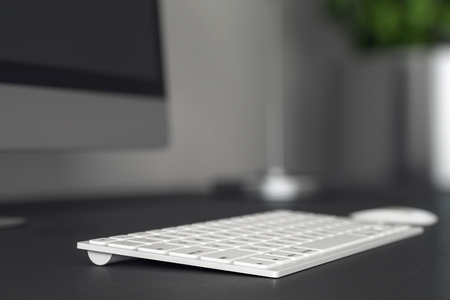 Close up and side view of computer keyboard on blurry grey desktop. Software and programming concept. 3D Rendering