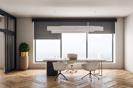 Modern office interior with desktop and chairs, window with city view and daylight, wooden floor and concrete walls. 3D Rendering
