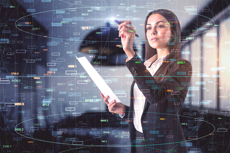 Attractive young european businesswoman with document in hand standing in blurry office interior with forex chart. Trade and stats concept. Double exposure