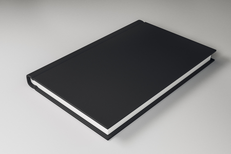 Empty closed black hardcover book on light background. Close up. Publish and info concept. Mock up, 3D Rendering