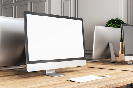 Creative designer desktop with empty white computer screen. Workplace concept. Mock up, 3D Rendering