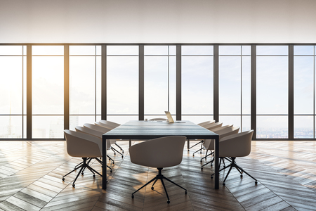 Clean meeting room interior with panoramic city view, furniture, laptop on desktop and daylight. Toned image. 3D Rendering Banco de Imagens