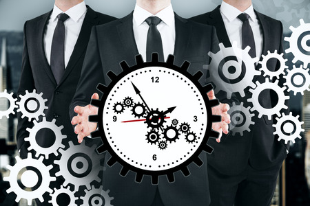 Three unrecognizable businessmen with creative gear clock on subtle background. Teamwork, time management and cogwheel concept. Multiexposure Stok Fotoğraf