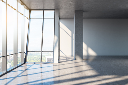 Contemporary empty office interior with concrete floor, panoramic city view, sunlight and shadows. 3D Rendering