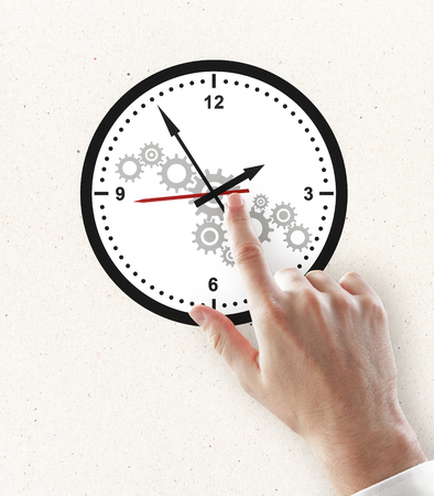 Hand pointing at creative gear cogwheel clock sketch on subtle white background. Time management and industry concept
