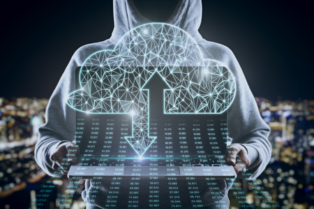 Hacker holding laptop with polygonal cloud and binary code stream on blurry night city background. Computing and hacking concept. Multiexposure