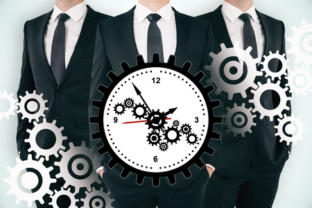 Three unrecognizable businessmen with creative gear clock on subtle background. Teamwork, time management and deadline concept. Double exposure 版權商用圖片