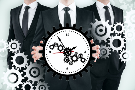 Three unrecognizable businessmen with creative gear clock on subtle background. Teamwork, time management and mechanism concept. Double exposure