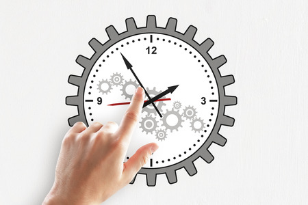 Hand pointing at creative gear cogwheel clock sketch on subtle white background. Time management and mechanism concept Banco de Imagens