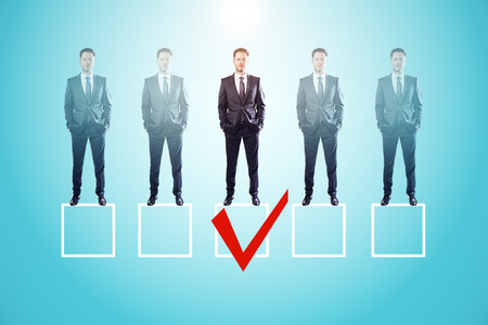 Faded row of businessmen on blue background with one red tick in box. Talent search and HR concept