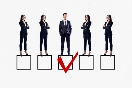 Row of businesswomen and man on white background with one red tick in box. Talent search and HR concept 版權商用圖片