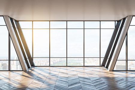 New empty office interior with wooden floor, panoramic city view, sunlight and shadows. 3D Rendering