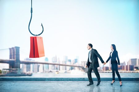 Businessman and woman following hook with shopping bags on blurry New York city background. Teamwork and Consumerism concept