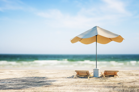 Beautiful beach background with  sand, chaise longs, umbrella and sunlight. Creativity and nature concept
