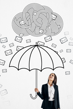 Pretty young businesswoman protecting himself from email cloud rain with drawn umbrella. Communication overload concept Stock Photo