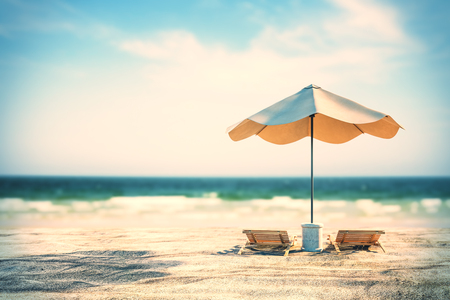Beautiful beach backdrop with sand, chaise longs, umbrella and sunlight. Creativity and nature concept